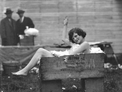 Naked_girl_a_box_of_rabbit_fur_1920s